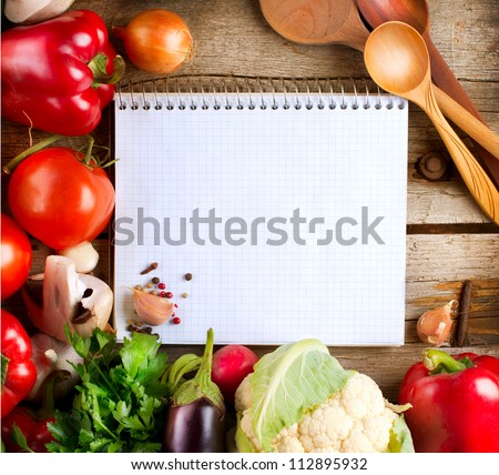 Fresh Organic Vegetables and Spices on a Wooden Background and Paper for Notes. Open Notebook and Fresh Vegetables Background.Diet.Dieting.Space For Your Text - stock photo