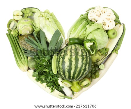 Fresh organic vegetables in shape of heart, close up - stock photo