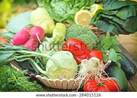 Fresh organic vegetables in wicker basket - stock photo