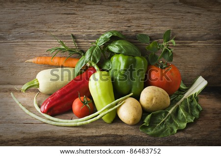 Fresh organic vegetables on a table close up - stock photo