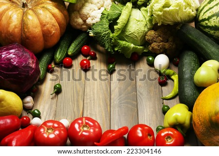 Fresh organic vegetables on wooden table, close up - stock photo