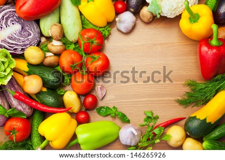Fresh Organic Vegetables on wooden Table / Round Composition with copy space - stock photo