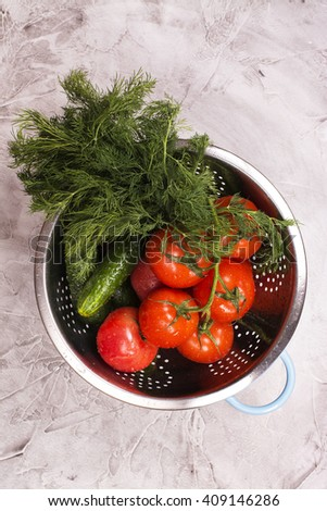 Fresh organic vegetables: tomatoes, cucumbers, dill over stone background. Selective focus - stock photo