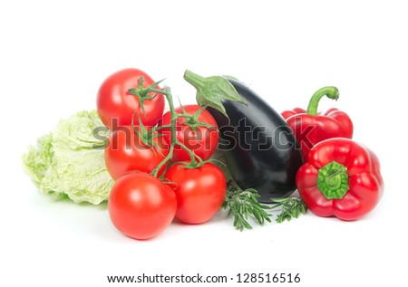 Fresh organic vegetarian food.  Healthy eating vegetables food concept tomatoes, salad, eggplant, red peppers on a white background. - stock photo