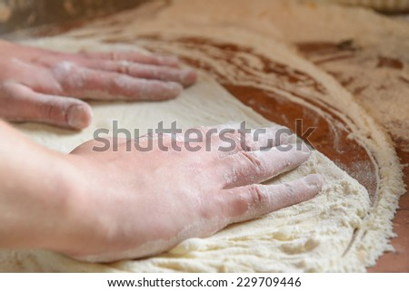 Fresh original Italian raw pizza, dough preparation in traditional style.  - stock photo