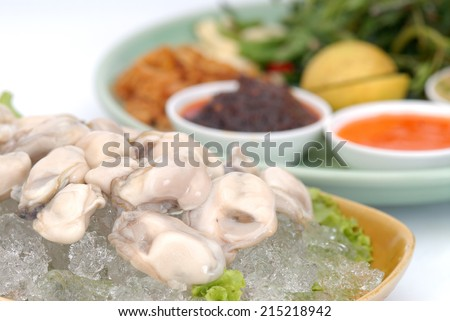 Fresh Oyster Salad,fresh oyster - served with of chili, garlic and lemon., - stock photo