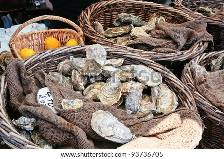 fresh oysters at market in Cancale, Brittany, France - stock photo