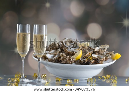 Fresh oysters with glass of champaigne - stock photo