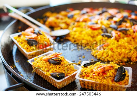 fresh paella prepared on mediterranean street market  in Provence, France. Selling and buying. Healthy local food market. - stock photo