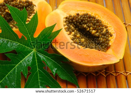 fresh papaya on bamboo - stock photo