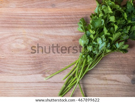 Fresh parsley herbs on wooden chopping board