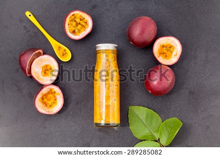 Fresh passion fruit and juice in the bottle for healthy and refresh. - stock photo