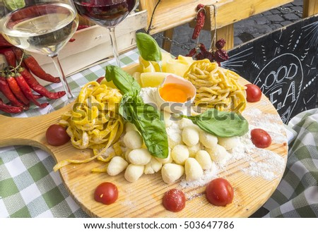 Fresh Pasta and Wine on Display Outside a Restaurant