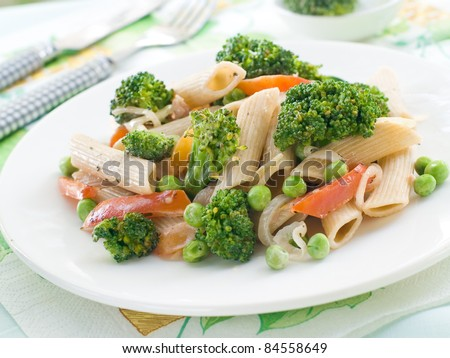 Fresh pasta with broccoli, pepper and peas. Selective focus - stock photo