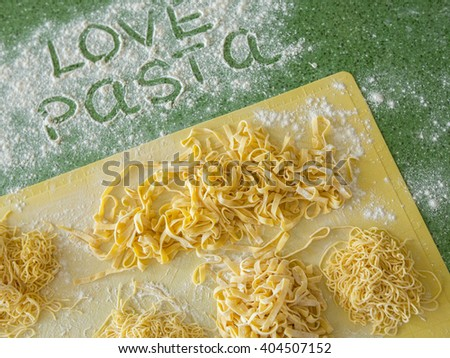 Fresh pasta with flour and egg close up - stock photo