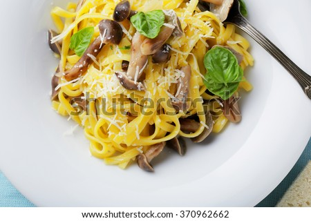 fresh pasta with mushrooms, food top - stock photo