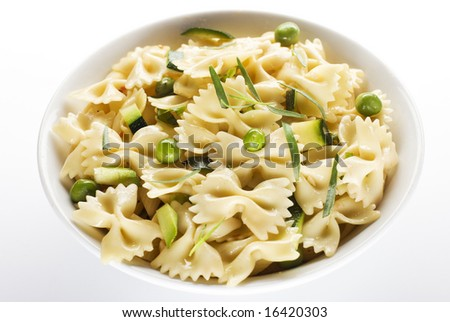 fresh pasta with peas and pumpkin isolated on white - stock photo