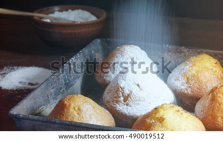 Fresh pastries sprinkled with powdered sugar.
