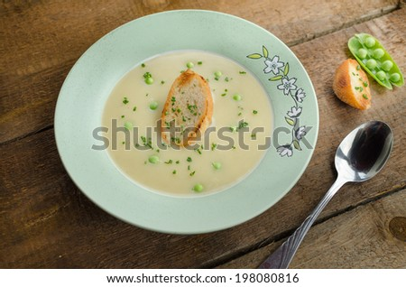 Fresh pea soup - stock photo