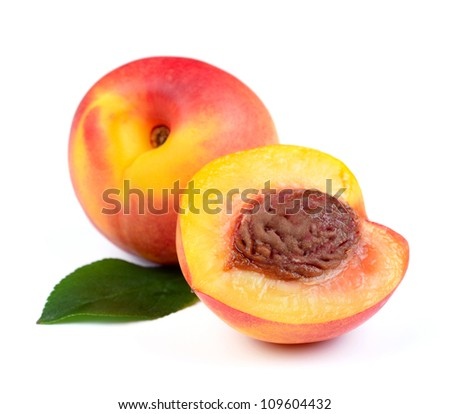 Fresh Peach Fruits with Green Leaf Isolated on White Background - stock photo