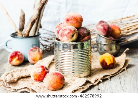 Fresh peaches in a tin, autumn rustic background,