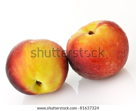 fresh peaches with waterdrops on white background - stock photo