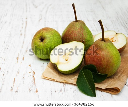 Fresh pears on a old wooden background - stock photo