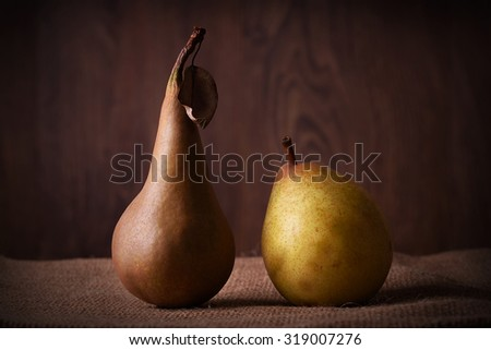 Fresh pears on sackcloth background. Fall fruit concept