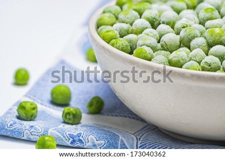 Fresh peas in a bowl - stock photo