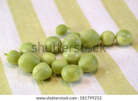 Fresh peas in their pods on a table,