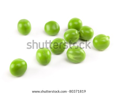 fresh peas isolated on white background - stock photo