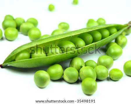 fresh peas on white background - stock photo