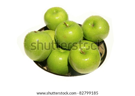 "fresh picked green ""granny smith"" apples in a bowl with water drops, isolated on white with room for your text"