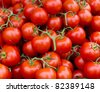 Fresh picked tomato clusters on display at the farmer's market - stock photo