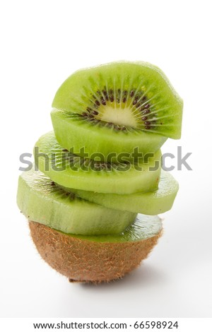 Fresh pieces kiwi fruit isolated on white background - stock photo