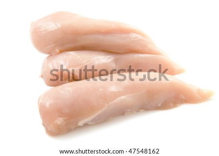 Fresh pieces of chicken filetisolated over white - stock photo