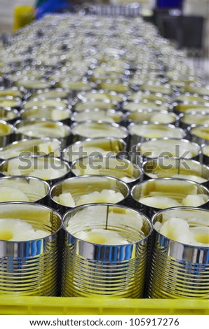 Fresh Pineapple slices in syrup in aluminum can - Tropical Fruits - stock photo
