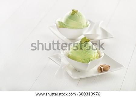 Fresh pistachio ice cream in cup close up. - stock photo