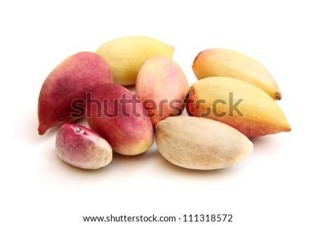 Fresh pistachios on a white background - stock photo