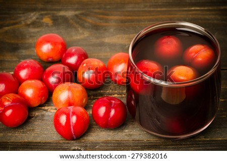 Fresh plum (Julee) and juice on wooden background,healthy food