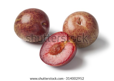 Fresh pluots  on white background