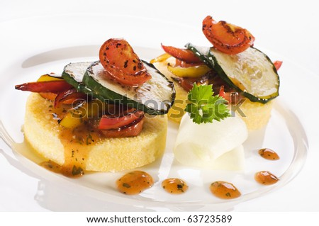Fresh polenta with roasted vegetables and sauce - stock photo