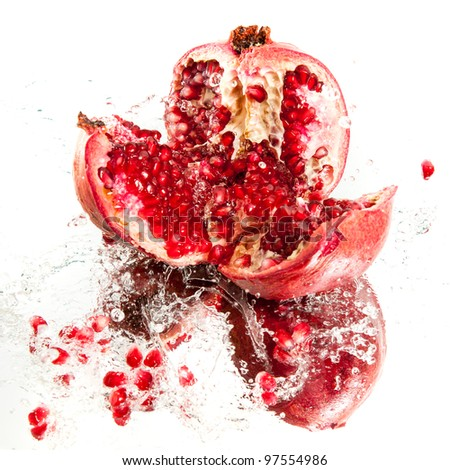 Fresh pomegranate in water splash - stock photo