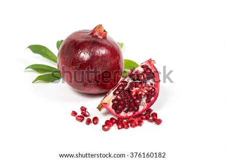 Fresh Pomegranate sliced with seeds on isolated white background
