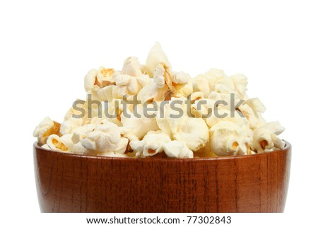 Fresh popcorn in wooden bowl isolated on white background - stock photo