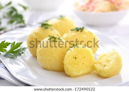 Fresh potato dumpling on a white plate - stock photo