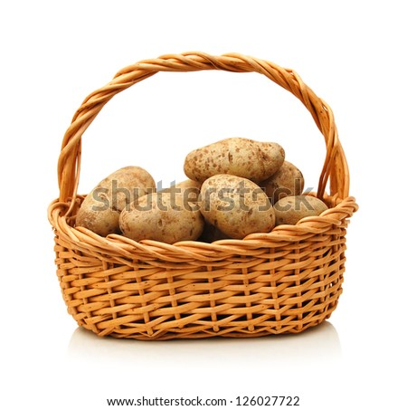 Fresh potatoes in  basket isolated on white