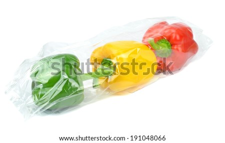 Fresh prepacked paprika peppers sealed in a cellophane bag  - stock photo