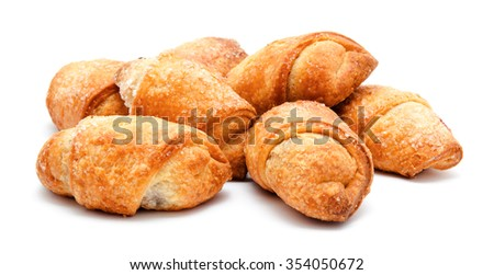 Fresh puff pastries isolated on a white background - stock photo
