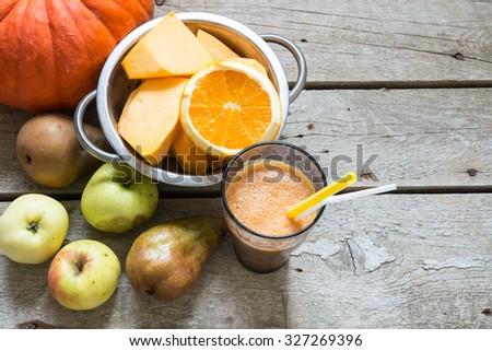 Fresh pumpkin juice with apples - stock photo